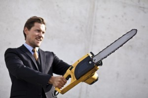 Kozzi-angry_businessman_wielding_a_chainsaw-3485x2323
