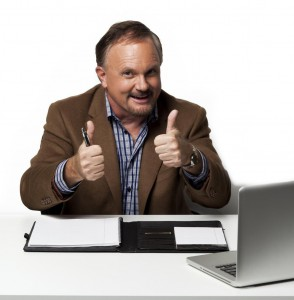 Kozzi-happy_mature_businessman_showing_thumbs_up-3710x5565